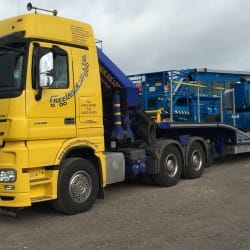 low loader truck with boom lift