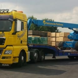access equipment delivered by low loader truck