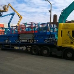 scissor lifts on low loader truck