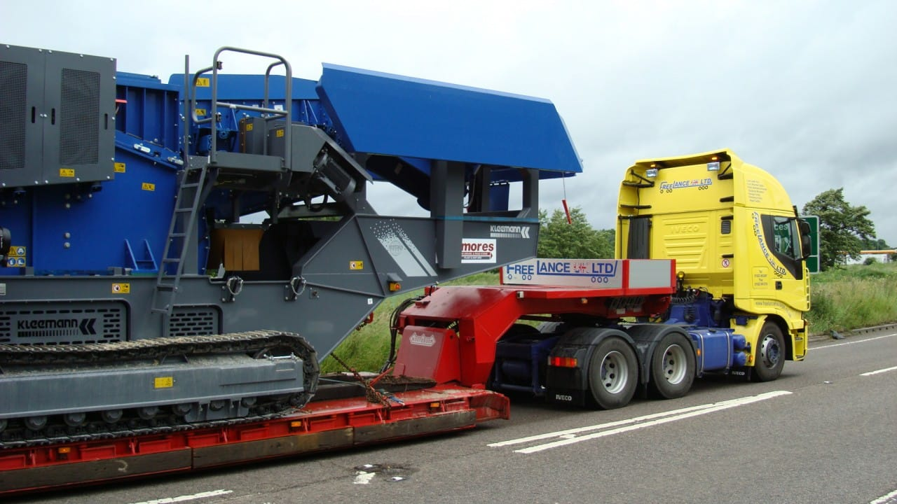 Specialist haulage truck delivering large access equipment